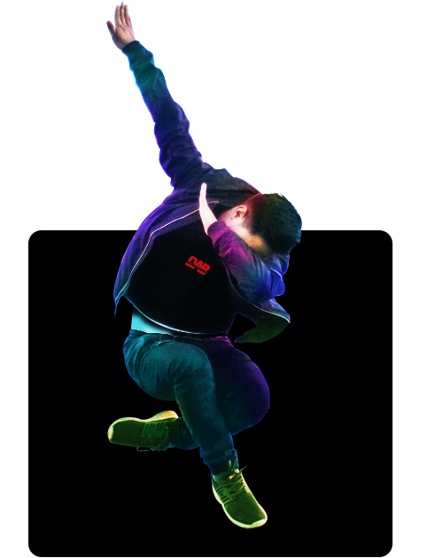 A boy jumping in the air while dabbing